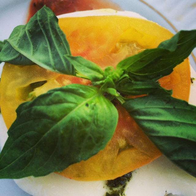 Stacked heirloom tomato caprese salad.
