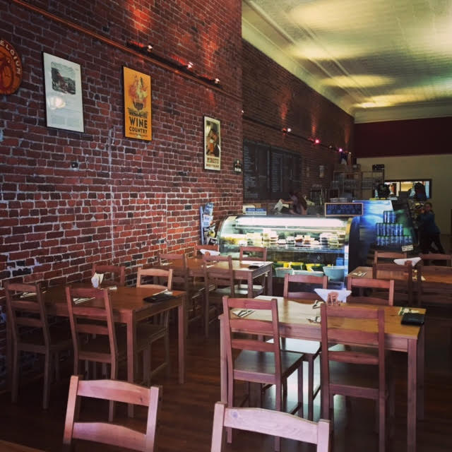 Exposed brick walls and wood floors grace the inside of downtown Walla Walla's Salumiere Cesario